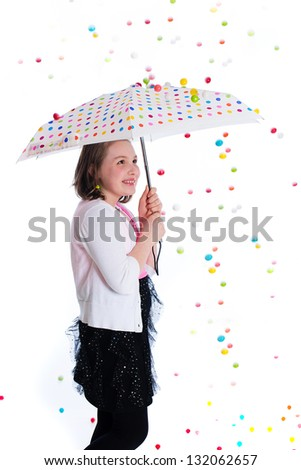 Gumball storm falling on an umbrella over a child.