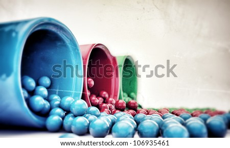 gumballs coming out from dispensers - stock photo