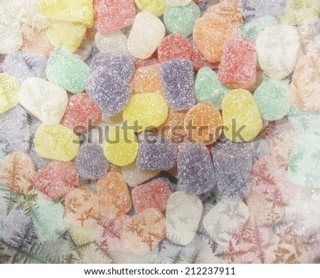 Gumdrops Christmas themed background with white frosty edges - stock photo