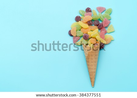gummi candy in a waffle cup, waffle cones with candy - stock photo