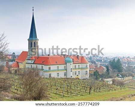 Gumpoldskirchen, AUSTRIA - 17  February 2015: The German Order resides in the castle of Guntramsdorf, Lower Austria. The castle is also a well-known landmark.  - stock photo