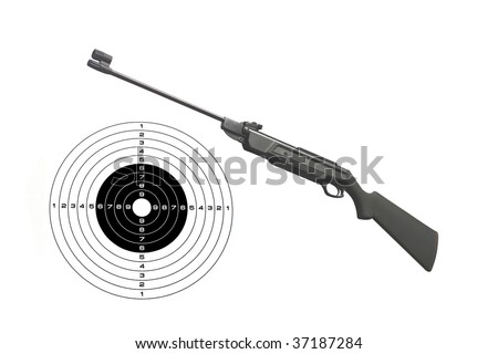 gun and a target under the light background - stock photo