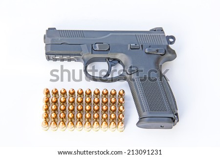 gun and ammo isolated on white  - stock photo