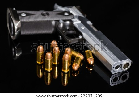 gun and bullets,closed up - stock photo