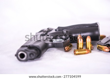 Gun and group of Bullets ,ammunition, on White background - stock photo