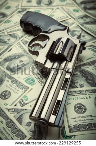 Gun and money concept