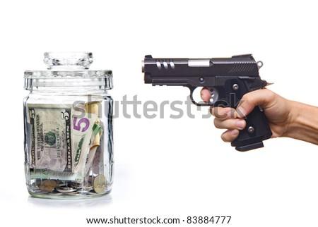 Gun and money on the white background - stock photo