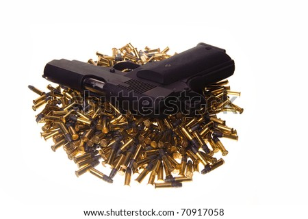 gun and pile of bullets - stock photo