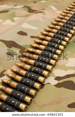 Gun belt, rounds for gun on multicam background - stock photo