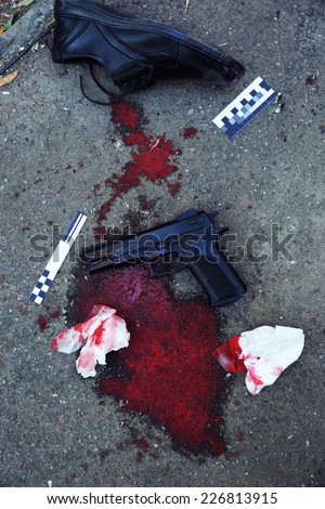 Gun, blood and evidence at crime scene  - stock photo