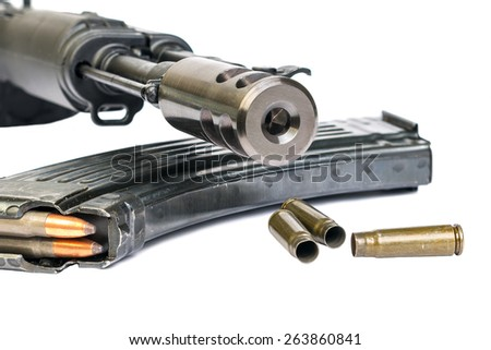 Gun, bullet shells - stock photo