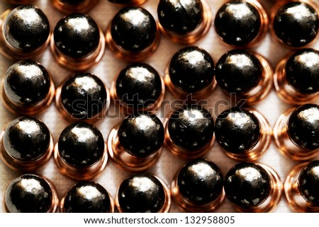 Gun bullets over white background