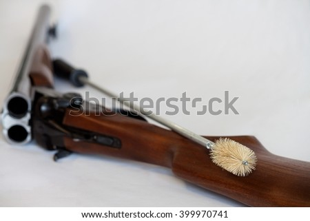 Gun cleaning kit on a white background. - stock photo