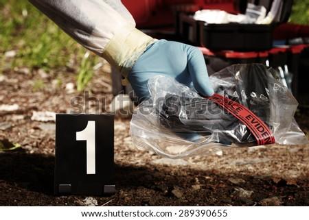 Gun control - pistol on crime scene - stock photo