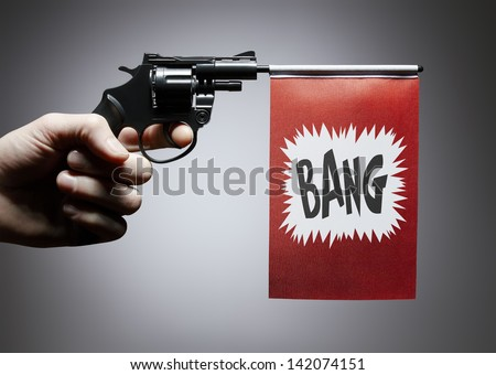 Gun crime concept of hand pistol showing a bang flag