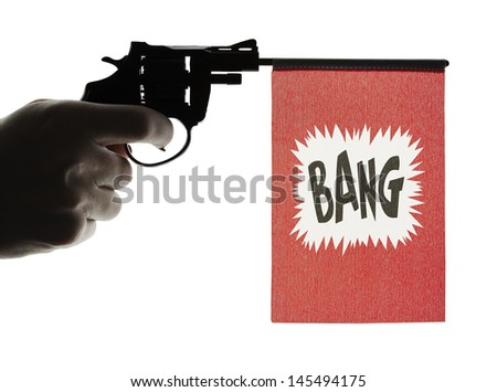 Gun crime concept of hand pistol showing a bang flag - stock photo