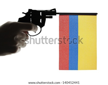 Gun crime concept of hand pistol showing the flag of colombia - stock photo