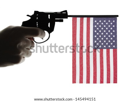 Gun crime concept of hand pistol showing the flag of united states of america - stock photo