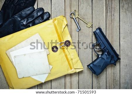 Gun  envelopes empty photos and keys - stock photo
