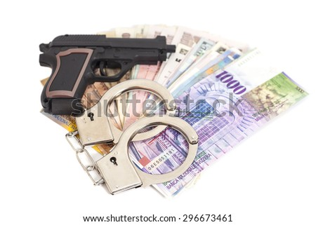 Gun, handcuffs and money isolated on white background