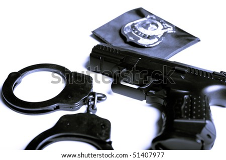 gun, handcuffs and police badge isolated