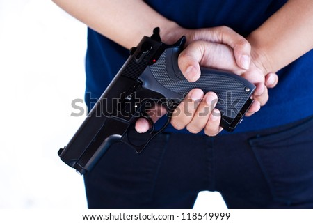 gun in girl hand - stock photo