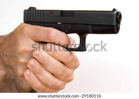 Gun in Hand - stock photo