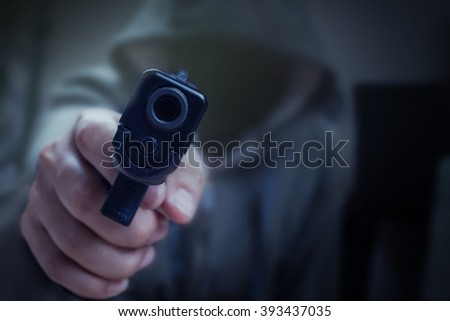 gun in hand and pointing with killer, safety and criminal concept background - stock photo