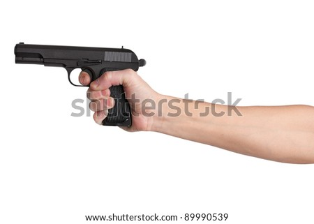 Gun in his outstretched hand of a man on  white background - stock photo