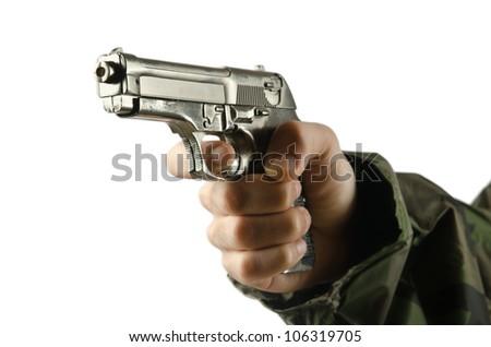 Gun in the hand on white - stock photo