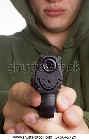 Gun in the hands of a gunman aimed shot. - stock photo