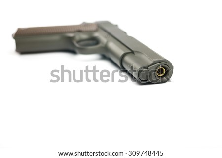 Gun isolated on white background / close up and focus on one point and  shallow depth of field - stock photo