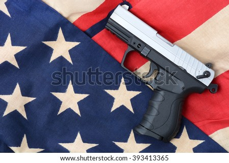 gun laying on a american flag