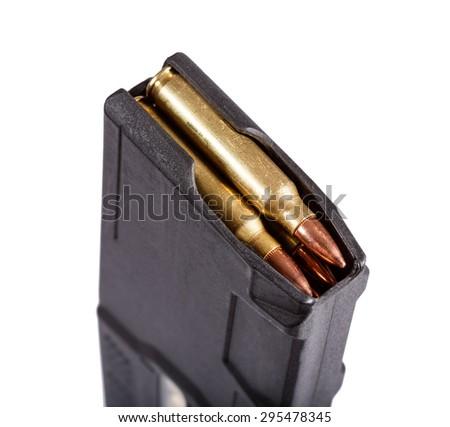 Gun magazin with ammo. - stock photo