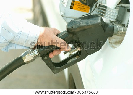 Gun petrol in the tank to fill - stock photo