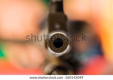 Gun point the submachine gun - stock photo
