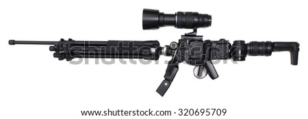 Gun (rifle) made out of photo gear (ambiguity); Photographic equipment arranged to a shape of assault rifle - stock photo