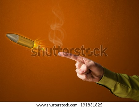 Gun shaped male hand with bullet coming out of it - stock photo