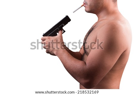 gun with a cigarette deadly concept isolated on a black background with clipping path - stock photo