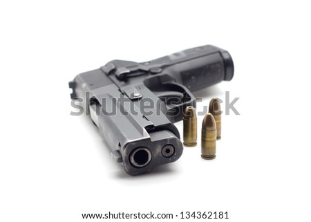 Gun with ammunition on white background - stock photo