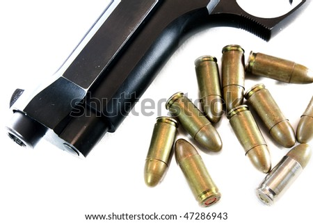 gun with bullets isolated on white - stock photo