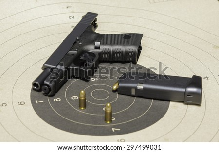Gun with magazine and ammo on the target (soft fogus) - stock photo