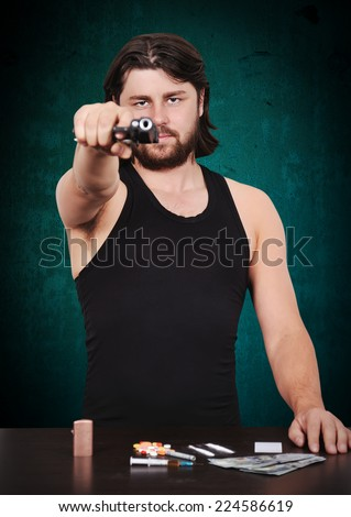 gunman shoots from gun om blue background - stock photo