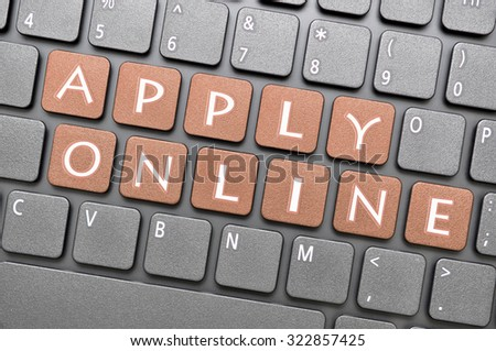 Gunmetal apply online key on keyboard - stock photo