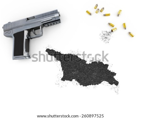 Gunpowder forming the shape of Georgia and a handgun.(series) - stock photo