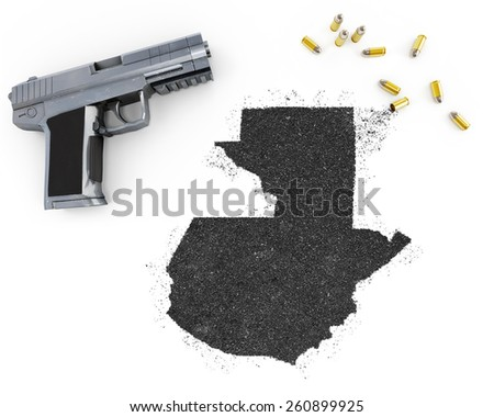 Gunpowder forming the shape of Guatemala and a handgun.(series) - stock photo