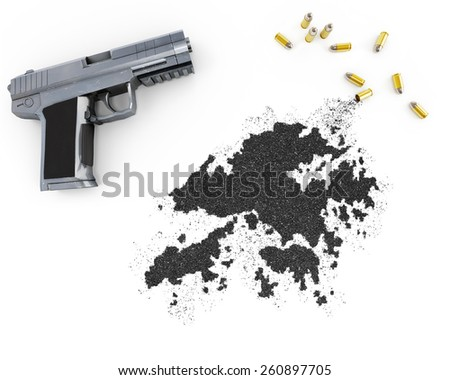 Gunpowder forming the shape of Hong Kong and a handgun.(series) - stock photo