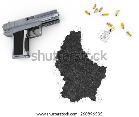 Gunpowder forming the shape of Luxembourg and a handgun.(series) - stock photo