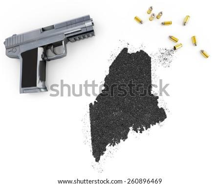 Gunpowder forming the shape of Maine and a handgun.(series) - stock photo