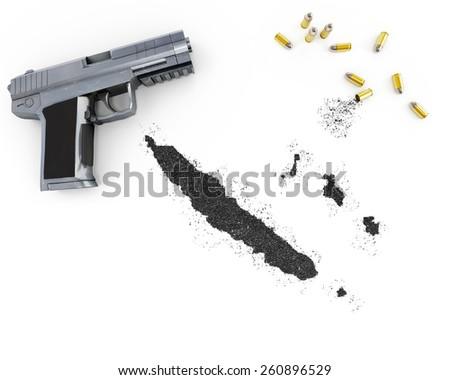 Gunpowder forming the shape of New Caledonia and a handgun.(series) - stock photo